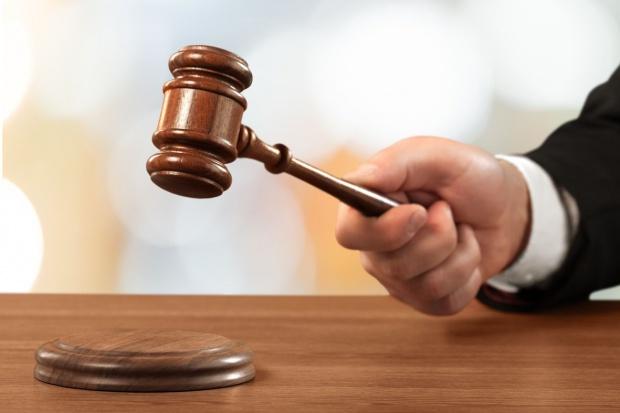 Komornik Sebastian Sz. skazany na 2,5 roku bezwzględnego więzienia