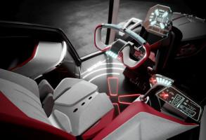 Wewnątrz kabiny panuje minimalistyczny design oraz futurystyczne kształty chociażby kierownicy, czy kolumny kierowniczej. fot. materiały prasowe